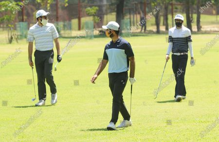 Stock Image of Professional golfers Rohan Kathuria (L), Karandeep Kochhar (C) and Shubhankar Sharma during a nine-hole round at Chandigarh Golf Club that has opened following relaxations in lockdown on May 20, 2020 in Chandigarh, India.