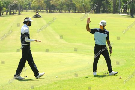 Stock Picture of Professional golfers Karandeep Kochhar (L) and Shubhankar Sharma during a nine-hole round at Chandigarh Golf Club that has opened following relaxations in lockdown on May 20, 2020 in Chandigarh, India.