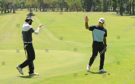 Professional golfers Karandeep Kochhar (L) and Shubhankar Sharma during a nine-hole round at Chandigarh Golf Club that has opened following relaxations in lockdown on May 20, 2020 in Chandigarh, India.