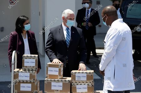 Vice President Mike Pence, center, and Seema Verma, Administrator of the Centers for Medicare and Medicaid, left, delivers personal protective equipment to a nursing home, in Orlando, Fla., as part of the initiative to deliver PPE to more than 15,000 nursing homes across America. Pence is also scheduled to participate in a roundtable discussion with hospitality and tourism industry leaders to discuss their plans for re-opening during the coronavirus outbreak