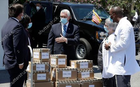 Vice President Mike Pence, second from right, Seema Verma, Administrator of the Centers for Medicare and Medicaid, second from left, and Florida Gov. Ron DeSantis deliver personal protective equipment to a nursing home, in Orlando, Fla., as part of the initiative to deliver PPE to more than 15,000 nursing homes across America. Pence is also scheduled to participate in a roundtable discussion with hospitality and tourism industry leaders to discuss their plans for re-opening during the coronavirus outbreak