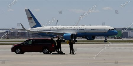 Air Force Two, with Vice President Mike Pence onboard, taxis at the Orlando International Airport, in Orlando, Fla. Pence is also scheduled to participate in a roundtable discussion with hospitality and tourism industry leaders to discuss their plans for re-opening