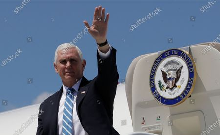 Vice President Mike Pence waves as he arrives at the Orlando International Airport, in Orlando, Fla. Pence is also scheduled to participate in a roundtable discussion with hospitality and tourism industry leaders to discuss their plans for re-opening during the coronavirus outbreak