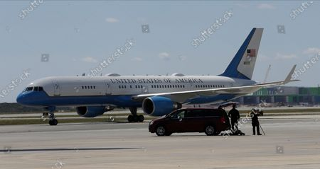 Air Force Two, with Vice President Mike Pence onboard, taxis at the Orlando International Airport, in Orlando, Fla. Pence is also scheduled to participate in a roundtable discussion with hospitality and tourism industry leaders to discuss their plans for re-opening during the coronavirus outbreak