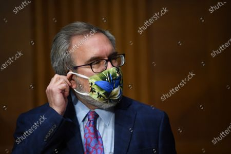 "Andrew Wheeler, Administrator, United States Environmental Protection Agency (EPA) adjusts his mask at a hearing titled ""Oversight of the Environmental Protection Agency"" in the Dirksen Senate Office Building in Washington, DC. Wheeler will be asked about the rollback of regulations by the Environment Protection Agency since the pandemic started in March."
