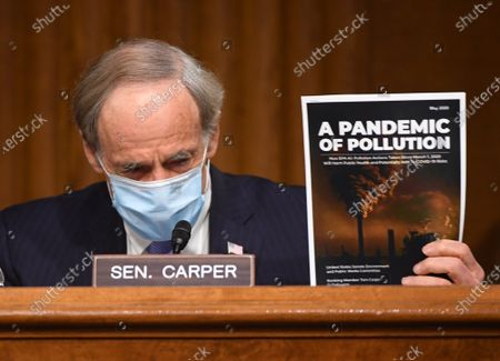 "United States Senator Tom Carper (Democrat of Delaware), ranking member, US Senate Environment and Public Works Committee, holds up a magazine as he delivers opening remarks at a hearing titled ""Oversight of the Environmental Protection Agency"" in the Dirksen Senate Office Building in Washington, DC. Andrew Wheeler, Administrator, United States Environmental Protection Agency (EPA) will be asked about the rollback of regulations by the Environment Protection Agency since the pandemic started in March."
