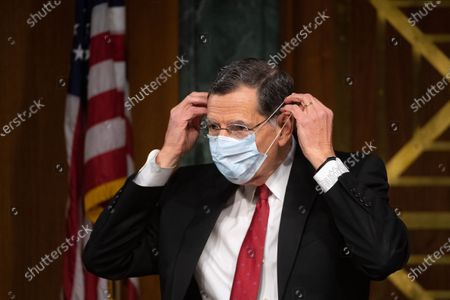 "Chairman Sen. John Brasso (R-WY) puts on a mask at a hearing titled ""Oversight of the Environmental Protection Agency"" before the US Senate Environment and Public Works Committee in the Dirksen Senate Office Building in Washington, DC. EPA Administrator Andrew Wheeler will be asked about the rollback of regulations by the Environment Protection Agency since the pandemic started in March."
