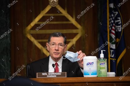 "Chairman Sen. John Brasso (R-WY) holds up a mask and shows off cleaning products at a hearing titled ""Oversight of the Environmental Protection Agency"" before the US Senate Environment and Public Works Committee in the Dirksen Senate Office Building in Washington, DC. EPA Administrator Andrew Wheeler will be asked about the rollback of regulations by the Environment Protection Agency since the pandemic started in March."