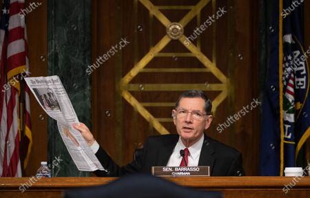 "United States Senator John Barrasso (Republican of Wyoming) holds newspaper at a hearing titled ""Oversight of the Environmental Protection Agency"" before the US Senate Environment and Public Works Committee in the Dirksen Senate Office Building in Washington, DC. EPA Administrator Andrew Wheeler will be asked about the rollback of regulations by the Environment Protection Agency since the pandemic started in March."