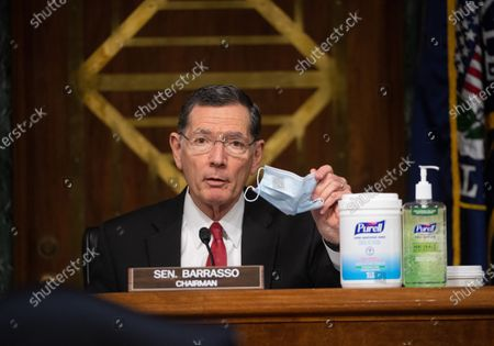 "United States Senator John Barrasso (Republican of Wyoming) holds up a mask and shows off cleaning products at a hearing titled ""Oversight of the Environmental Protection Agency"" before the US Senate Environment and Public Works Committee in the Dirksen Senate Office Building in Washington, DC. EPA Administrator Andrew Wheeler will be asked about the rollback of regulations by the Environment Protection Agency since the pandemic started in March."