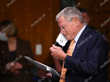 "United States Senator Jim Inhofe (Republican of Oklahoma) reads a document at a hearing titled ""Oversight of the Environmental Protection Agency"" before the US Senate Environment and Public Works Committee in the Dirksen Senate Office Building in Washington, DC. EPA Administrator Andrew Wheeler will be asked about the rollback of regulations by the Environment Protection Agency since the pandemic started in March."