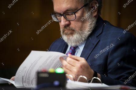 Andrew Wheeler, Administrator, United States Environmental Protection Agency (EPA), reviews his notes during a US Senate Environment and Public Works Committee hearing, on Capitol Hill in Washington, D.C., U.S.,.