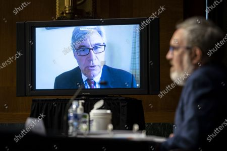 Stock Photo of United States Senator Sheldon Whitehouse (Democrat of Rhode Island), speaks virtually during a US Senate Environment and Public Works Committee hearing with Andrew Wheeler, administrator of the Environmental Protection Agency (EPA), on Capitol Hill in Washington, D.C., U.S.,.