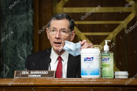 United States Senator John Barrasso (Republican of Wyoming) and chairman of the US Senate Environment and Public Works Committee, shows his face mask along with disinfectants on the dais during a hearing, on Capitol Hill in Washington, D.C., U.S.,.