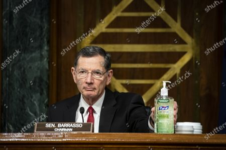 United States Senator John Barrasso (Republican of Wyoming) and chairman of the US Senate Environment and Public Works Committee, places a bottle of hand sanitizer on the dais during a hearing, on Capitol Hill in Washington, D.C., U.S.,.