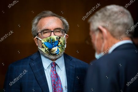 Andrew Wheeler, administrator of the Environmental Protection Agency (EPA), wears a face mask as he arrives during a Senate Environment and Public Works Committee hearing, on Capitol Hill in Washington, D.C., U.S.,.
