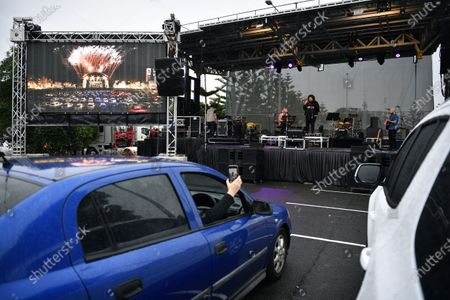 Casey Donovan (C-R, back) performs live during a drive-in concert at the Robyn Webster Sports Centre in Sydney, Australia, 21 May 2020. The concert was organized as part of the music industry's effort to return to live shows without defying coronavirus restrictions. Up to 600 people were allowed to attend the event.