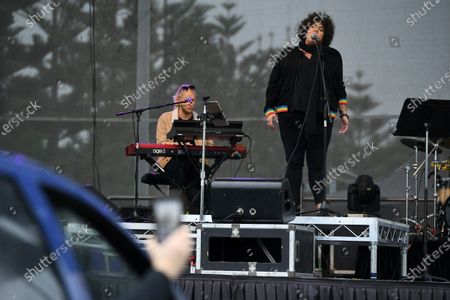 Casey Donovan (R) performs live during a drive-in concert at the Robyn Webster Sports Centre in Sydney, Australia, 21 May 2020. The concert was organized as part of the music industry's effort to return to live shows without defying coronavirus restrictions. Up to 600 people were allowed to attend the event.