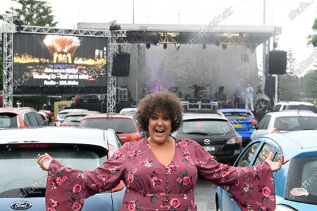 Casey Donovan poses for a photo ahead of performing a drive-in concert at the Robyn Webster Sports Centre in Sydney, New South Wales, Australia, 21 May 2020. The concert was organized as part of the music industry's effort to return to live shows without defying coronavirus restrictions. Up to 600 people were allowed to attend the event.