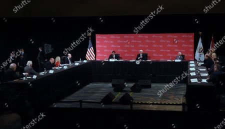 Florida Gov. Ron DeSantis (center left) and U.S. Vice President Mike Pence (center) participate in a roundtable discussion with hospitality and tourism industry leaders to discuss Florida's phased economic reopening during the coronavirus pandemic.