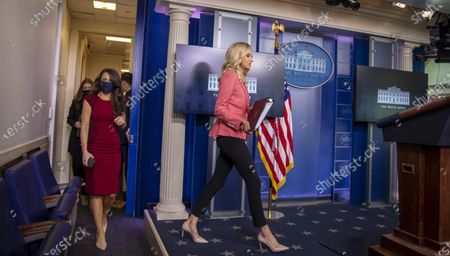 White House Press Secretary Kayleigh McEnany arrives to give remarks during a press briefing in the James S. Brady Briefing Room of the White House in Washington, D.C..