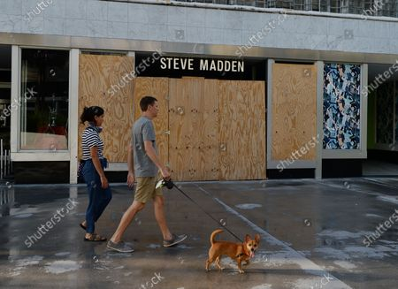 A general view of the Steve Madden store on Lincoln Road as people are seen going about their daily activities as businesses begin to re open phase one during the Coronavirus COVID-19 pandemic, Miami Beach, Florida, USA