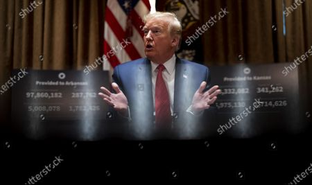 Stock Image of United States President Donald J. Trump makes remarks as he attends a meeting with Governor Asa Hutchinson (Republican of Arkansas) and Governor Laura Kelly (Democrat of Kansas) in the Cabinet Room of the White House in Washington, DC,.