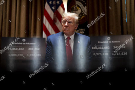 United States President Donald J. Trump makes remarks as he attends a meeting with Governor Asa Hutchinson (Republican of Arkansas) and Governor Laura Kelly (Democrat of Kansas) in the Cabinet Room of the White House in Washington, DC,.