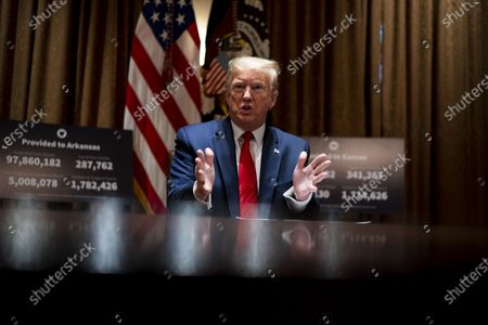 Stock Picture of United States President Donald J. Trump makes remarks as he attends a meeting with Governor Asa Hutchinson (Republican of Arkansas) and Governor Laura Kelly (Democrat of Kansas) in the Cabinet Room of the White House in Washington, DC,.