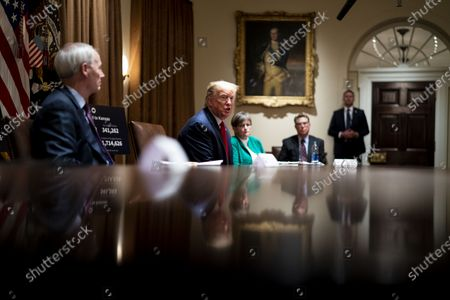 United States President Donald J. Trump makes remarks as he attends a meeting with Governor Asa Hutchinson (Republican of Arkansas), left, and Governor Laura Kelly (Democrat of Kansas) in the Cabinet Room of the White House in Washington, DC,.