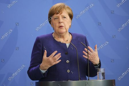 Stock Photo of German Chancellor Angela Merkel holds a press conference at the chancellery. German Chancellor Angela Merkel informed about a video conference held with the chairs of international economic and financial organizations, aim to address issues caused by the spread of the coronavirus SARS-CoV-2 which causes the COVID-19 disease.