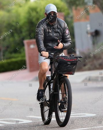 Michael Keaton cycling on his bicycle