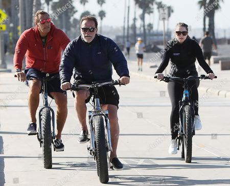 Ralf Moeller, Arnold Schwarzenegger and Katherine Schwarzenegger cycling
