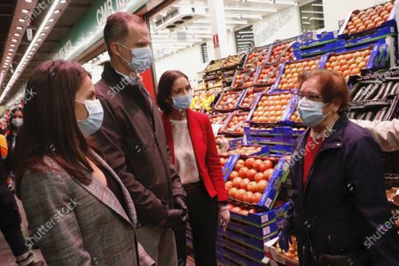 Stock Picture of King Felipe VI, Queen Letizia visit Mercamadrid, the biggest market in Spain