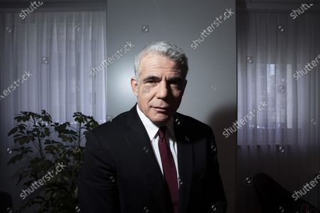 Stock Photo of Israel's opposition leader Yair Lapid poses for a photo at his office in Tel Aviv, Israel