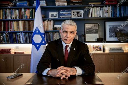 Israel's opposition leader Yair Lapid poses for a photo at his office in Tel Aviv, Israel