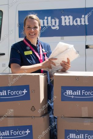 Stevenage, Mail Force protective equipment for healthcare workers. Their arrival marked the end of a 2,000-mile, week-long journey across the continent from Turkey. In their cargo were 100,000 gowns bought by the Mail Force charity to help solve the PPE crisis. Staff at the Lister Hospital in Stevenage, pictured receiving the latest delivery of PPE provided by Daily Mail reader donations to the charity Mail Force. The delivery included Turkish made gowns which arrived in the UK last weekend.  Left to right are Porter Ian Kelsey, Nurse Lorraine Williams, Director of Nursing Rachael Corser, Nurse Anette Overman, Porter Kevin Chambers, Nurse Mae Cometa, and Porter Mark Antoni.