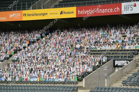 Stock Image of The fans of Borussia Monchengladbach want to contribute to a better mood during the ghost games in the Bundesliga. To save TV viewers and professionals the view of the empty stadium seats, cardboard figures with the likeness of the trailers were put up in life size if desired, where the spectators stand or sit during normal games