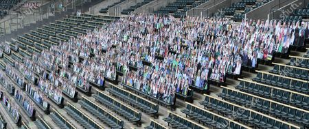 Stock Picture of The fans of Borussia Monchengladbach want to contribute to a better mood during the ghost games in the Bundesliga. To save TV viewers and professionals the view of the empty stadium seats, cardboard figures with the likeness of the trailers were put up in life size if desired, where the spectators stand or sit during normal games