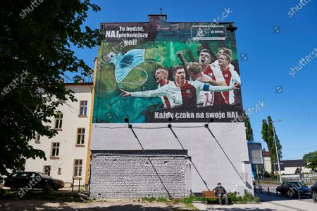 A huge mural featuring players of the Polish national soccerl team on the wall of one of the tenements in Gdansk, Poland 21 May 2020. The painting with images of Jacek Goralski, Robert Lewandowski, Kamil Grosicki, Krzysztof Piatek, Piotr Zielinski and Grzegorz Krychowiak is part of the socio-image campaign which aims to raise funds for research related to the coronovirus epidemic.