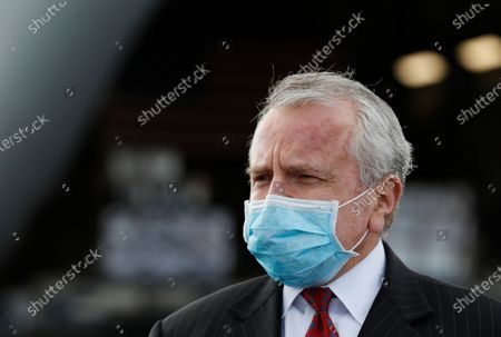 U.S. ambassador to Russia John Sullivan wearing a protective face mask stands next to a U.S. Air Force C-17 Globemaster transport plane which delivered the first batch of medical aid from the United States, including 50 ventilators, at Vnukovo International Airport amid   the outbreak of the pandemic Covid-19 disease caused by the SARS-CoV-2 coronavirus in Moscow, Russia, 21 May 2020.
