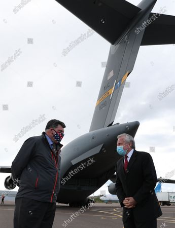 U.S. ambassador to Russia John Sullivan (R) and Brock Bierman, Assistant Administrator of the U.S. Agency for International Development (USAID), stand next to a U.S. Air Force C-17 Globemaster transport plane which delivered the first batch of medical aid from the United States, including 50 ventilators, at Vnukovo International Airport amid the outbreak of the pandemic Covid-19 disease caused by the SARS-CoV-2 coronavirus in Moscow, Russia, 21 May 2020.