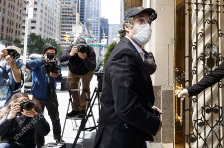 Michael Cohen, President Donald Trump's former lawyer, arrives to his apartment building after being released on furlough today from federal prison because of the coronavirus to serve the rest of his sentence under home confinement in New York, New York, USA, 21 May 2020. Cohen plead guilty last May to federal charges including campaign finance fraud and lying to Congress and was originally scheduled to be released from prison in November 2021.