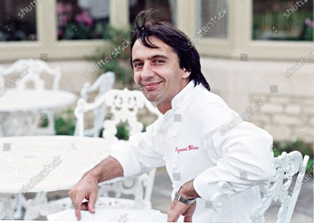 Stock Picture of Chef Raymond Blanc, poses at his Award Winning Total and Restaurant Le Manior Aux Quat' Saisons 1990