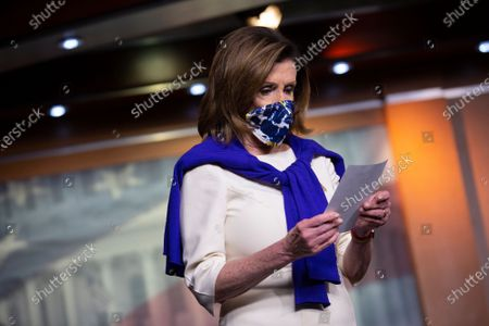 Speaker of the United States House of Representatives Nancy Pelosi (Democrat of California) looks over notes during a news conference regarding the vote by mail provision in the Heroes Act at the United States Capitol in Washington D.C., U.S..