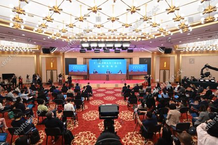 Reporters attend a press conference of the third session of the 13th National People's Congress (NPC) via video link in Beijing, capital of China, May 21, 2020. The NPC, China's top legislature, held a press conference Thursday night ahead of its annual session in Beijing. Zhang Yesui, spokesperson for the third session of the 13th NPC, took questions from Chinese and foreign reporters on the agenda of the session and work of the NPC via video link.