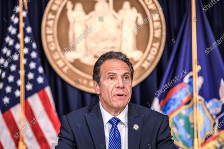 Stock Photo of New York Governor Andrew Cuomo attends to journalists during a news conference. New York is the epicenter in the world of the new coronavirus pandemic (COVID-19).