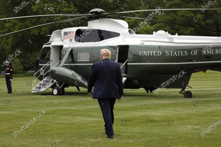 United States President Donald J. Trump walks to board Marine One on the South Lawn of the White House in Washington, DC before his departure to Detroit, Michigan. Trump is going to participate in a listening session with African-American leaders and tour Ford Rawsonville Components Plant in Ypsilanti, Michigan.