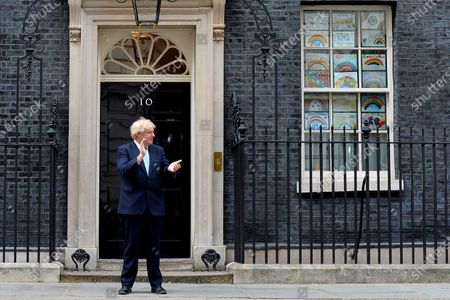 Boris Johnson takes part in the Clap For Our Carers during the Covid-19 outbreak at No.10 Downing Street.