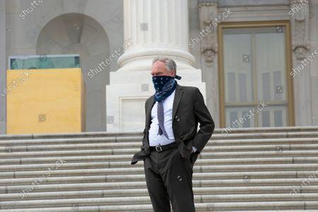 Stock Photo of United States Senator Tim Kaine (Democrat of Virginia) speaks to United States Senator Thom Tillis (Republican of North Carolina), not pictured, as he enters the United States Capitol in Washington D.C., U.S..